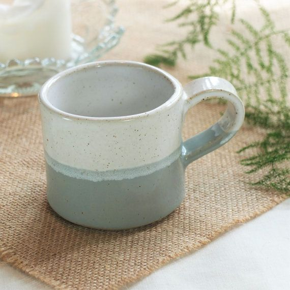 The white glaze on the interior of these simple, contemporary mugs overlaps and bleeds lightly into the colour on the outside. These mugs are ideal coffee or tea mugs, holding approximately 200mls and work perfectly on their own or as a set in a combination of colours. All my pieces are stoneware pottery and glazed in food safe glazes. Each one is formed individually by hand without using any moulds and will therefore have their own unique character, shape and imperfections. As with any…