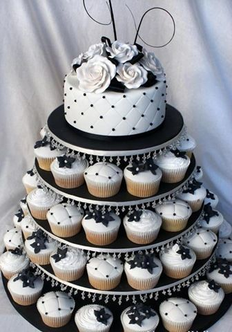 cupcakes wedding cake, but in Tiffany blue and silver cupcakes and the top red...?