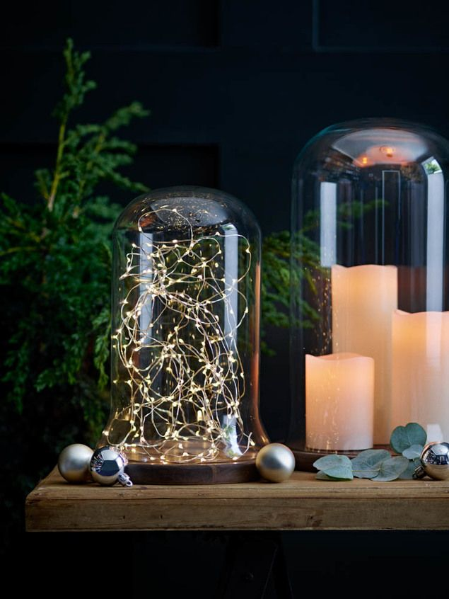 Style your way to a cosy home. Winter it the perfect time for me to start to being playful in my home, creating displays out of glass domes and led lights. I fill bowls full of baubles and glitter and battery powered fairy lights. They look so good in an empty fireplace or on a mantlepiece. These ones from BHS
