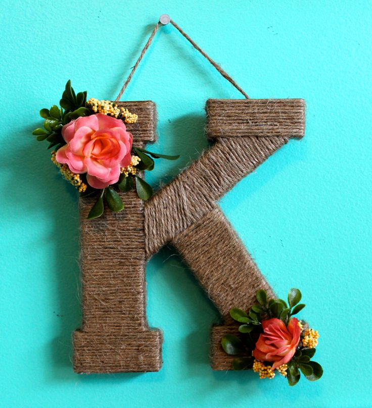 3D Twine letter. Great for gifts or sorority letters!  {supplies} -twine -rose bunch -accessory flower bunch -leaf bunch -wooden letter -hot glue YAY MICHAEL'S