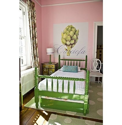 This bed looks like it was inherited from Granny and given a fresh look with glossy grass-green paint. The artichoke wall covering adds a large, playful touch.
