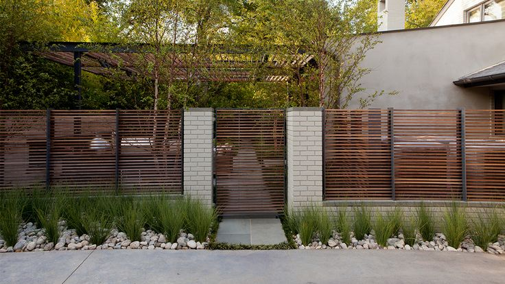 semi-transparent :: wood fence + brick gateway