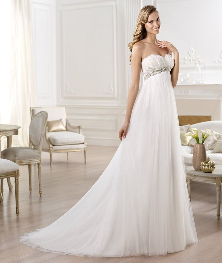 PRONOVIAS ~ 2014 Fashion ~ OJEDA Style 26/56 ~ Soft tulle empire line wedding dress. Sweetheart neckline covered with ivory feathers. Silver and pearl gemstone embroidery below the bust. Soft tulle empire line wedding dress