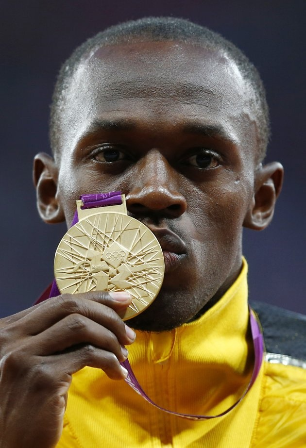 Jamaica's Usain Bolt kisses his gold medal during the men's 100m victory ceremony during the London 2012 Olympic Games