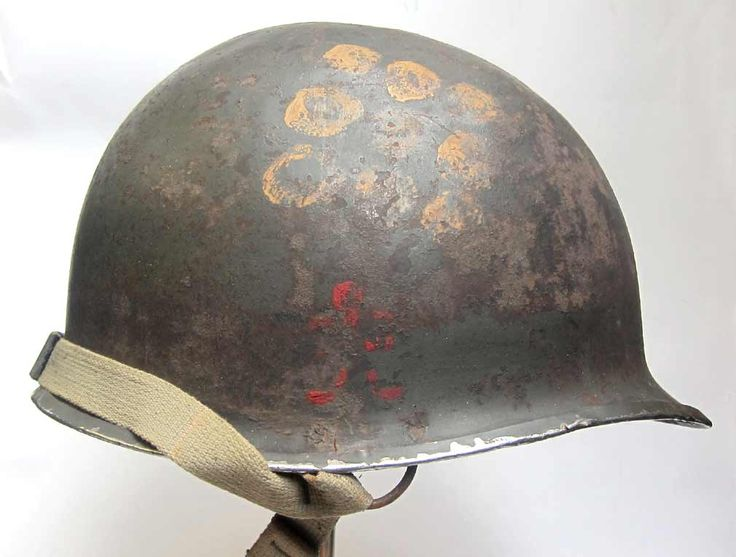 The unsung Band of Brothers - USA 509th PIR GERONIMO  This is a 'reproine' helmet - mixture of reproduction and genuine parts. The shell is a genuine WW2 McCord helmet. It is a front seam, stainless rim and the paintwork is also original. One of the bales has been welded repaired showing that it was an original fixed or 'D' bale. We have retained the welds and added our 'D' bales.   www.warhats.com