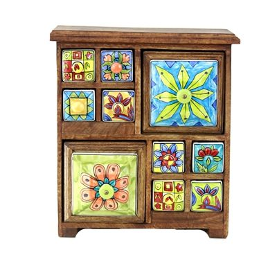 Brighten up your room with this colorful hand painted ceramic drawer chest.