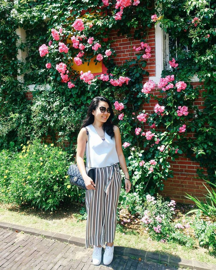 Hey flower wall, you beautiful thing!  // Huis Ten Bosch, Sasebo, Nagasaki Prefecture, Japan. instagram: @quennandher  // ZARA striped pants // TOPSHOPSTYLE cropped top // MIU MIU sunglasses // CHANEL Perfect Edge navy blue flap bag // KEDS Triple white platform sneakers