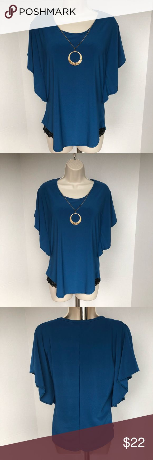 AMERICAN CITY WEAR BLOUSE Beautiful blue batwing blouse with gold circle pendant American City Wear Tops Blouses