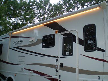 Awesome mod - They wired a key fob to act as a remote control for a strand of lights under the awning.  Now they can turn on the lights if they come home after dark, AND they can make the lights flash by hitting the panic button if there's an emergency.  Brilliant!