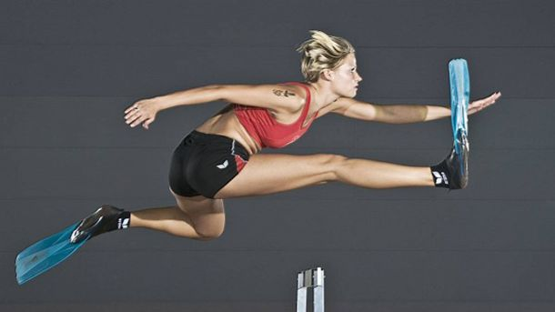 Guinness World Record: Fastest Hundred Meter Hurdle Wearing Swim Fins. - We're not sure how many people have actually taken a shot at this one but on September 13, 2008 Maren Zonker of Germany became the new world record holder with a time of 22.35 seconds