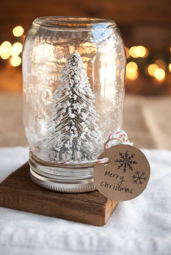 christmas decor craft diy -- diy anthropologie mason jar snow globes. these would make great gifts for people or awesome for a mantle or centerpiece