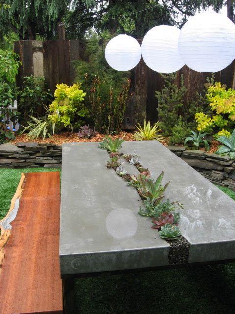 perfect backyard retreat! concrete table, wood bench, lanterns & landscaping!