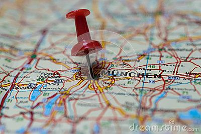 Macro shot of Munich map with push pin