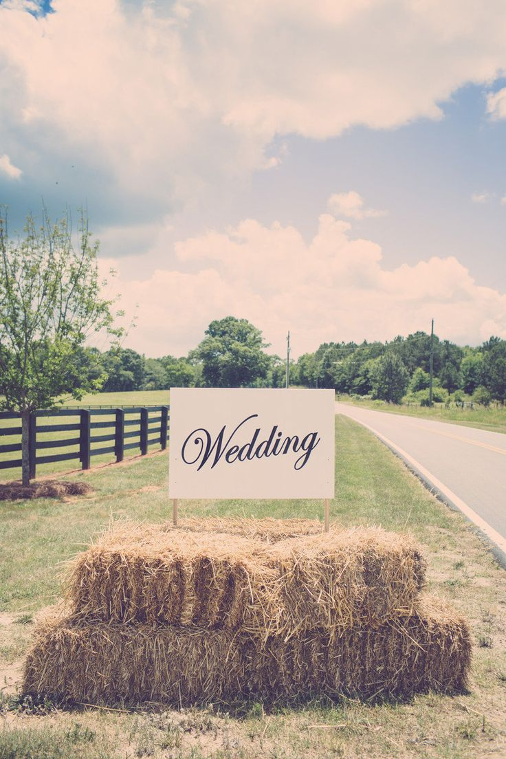 Sign outside the wedding venue placed in hay bales