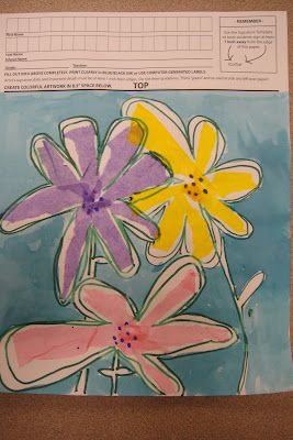 Kindergarten flowers.  Tissue paper flowers with watered down glue (i like liquid starch) then outlined in marker and paint the background