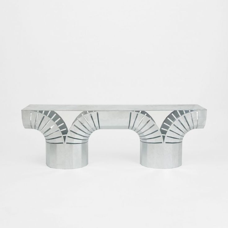 Jamie Wolfond's mathematical design method met with Sigve Knuton's instinctive approach to create the Split Bench, created by bending a flat sheet of metal. The base is shaped into two columns that split in half and curve in opposite directions, while the sides are marked with thin perforations.