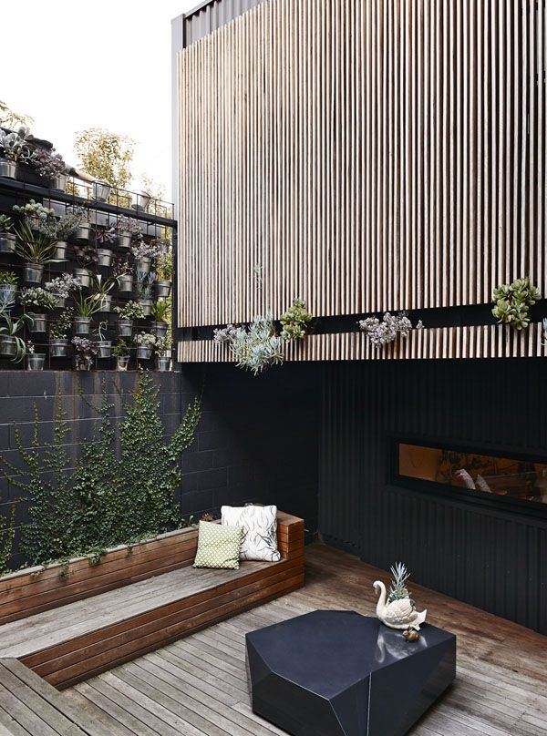 narrow, vertical wood on exterior + built in seating | the design files