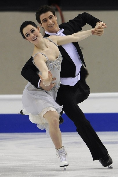 Canada's Tessa Virtue and Scott Moir perform during the Ice Dance compulsory dance competition of the World Figure Skating Championships on March 23, 2010 at the Palavela ice-rink in Turin.