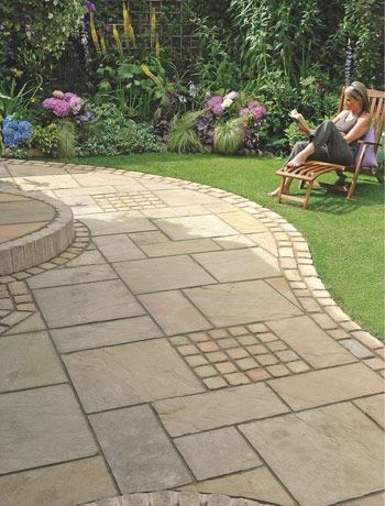 Add shape to a plain lawn with curved paving