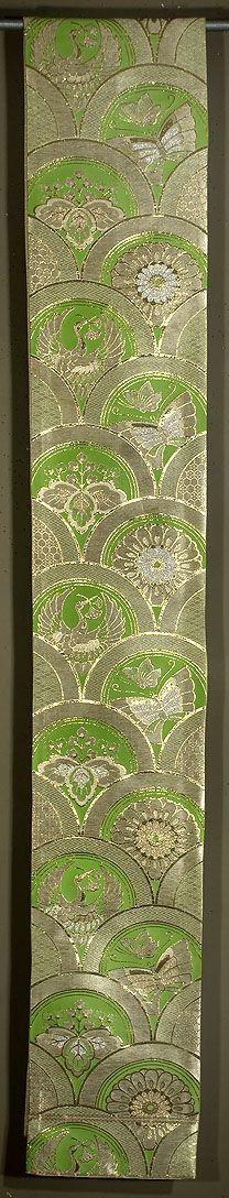 """Japanese Fukuro Obi  12""""x 156""""  Decorated section: 12""""x 94""""  Gold and silver brocading on silk.  Cranes, butterflies, mums, and paulownia leaves.  The metallic brocading in this obi is more gold than these photos suggest, with more """"sparkle."""""""