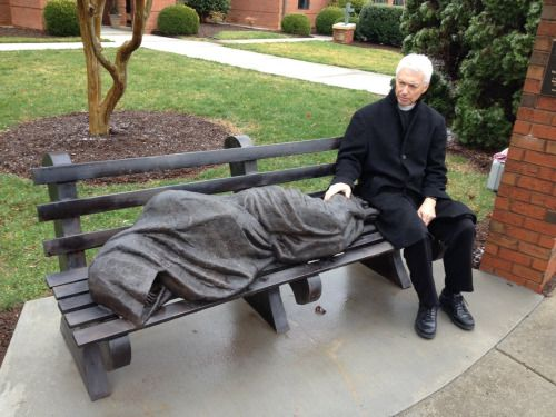 """The statue depicts Jesus as a vagrant sleeping on a park bench. St. Alban's Episcopal Church,  installed the homeless Jesus statue on its property in the middle of an upscale neighborhood filled with well-kept townhomes."""