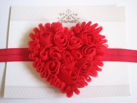Red shabby heart with a red sequin bow, heart measures 3 inches across, attached to a red headbands.    If you would like the flower on a skinny