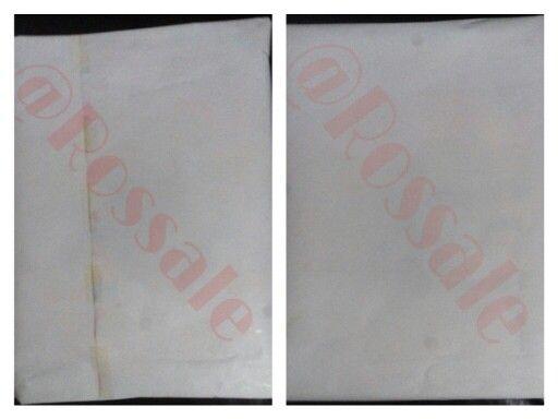 Tampak depan dan belakang barang yang terjual yang dibungkus dengan kertas pembungkus putih sebagai lapisan akhir.