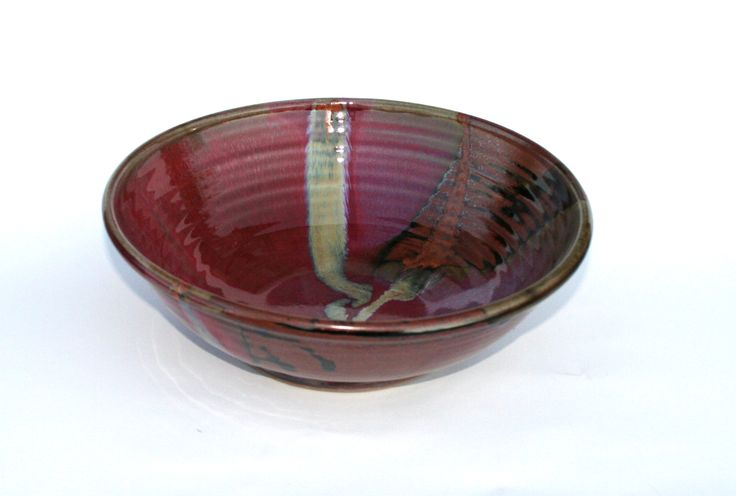 Chez Red / temoky: large salad bowl or serving dish - Glossy copper red glaze. Deep tones spanning from copper/rust to venetian reds.  Partnered with a matt brown, with lines of black where the glaze breaks on the edges.