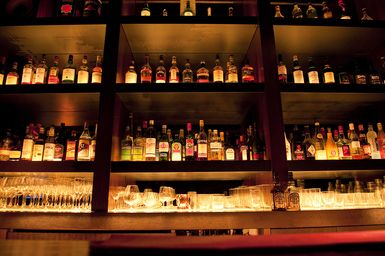 Learn Your Liqueur Liquor bottles behind a bar - Mitsuhiro Ouchi / a.collectionRF / Getty Images