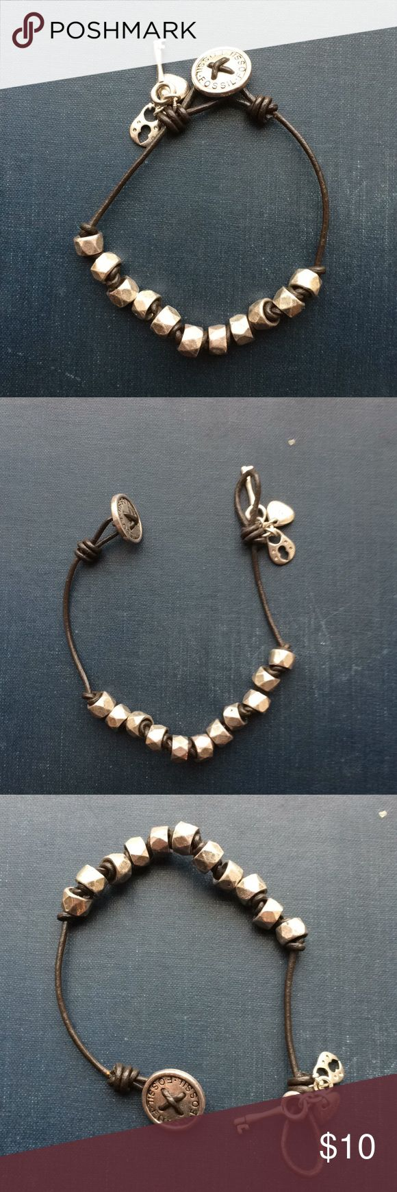 Fossil leather charm wrap silver bead bracelet Fossil leathet bracelet with silver beads and tiny charms. Barely worn. Fossil Jewelry Bracelets