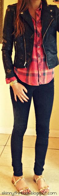 black leather jacket, red plaid shirt, black skinny jeans, gold watch, gold and white sandals