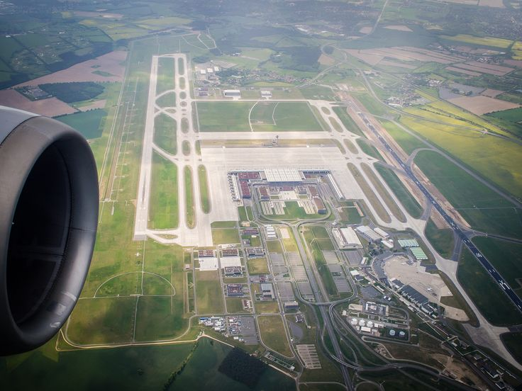 Berlin Brandenburg Airport ~ gmp Architekten (2018?) ~ Built to the south of the Berlin Schönefeld Airport, Brandenburg has widened and lengthened the original runway (at right) and included a parallel runway to the south of the new terminal (at left).
