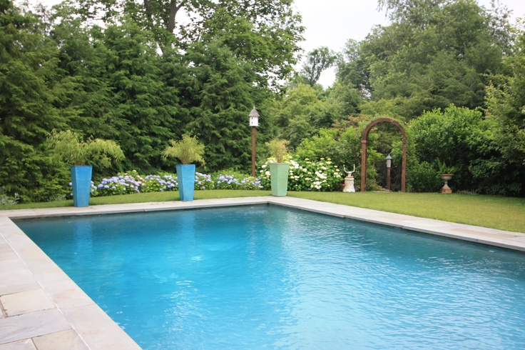 Blue planters by the pool by fairfield house garden for Garden grove pool fairfield