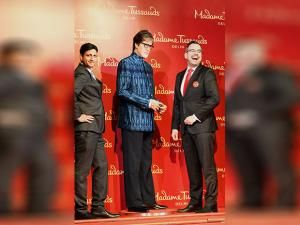 Anshul Jain Merlin Entertainments India Ltd, and Marcel Kloos pose with the wax statue of Amitabh Bachchan