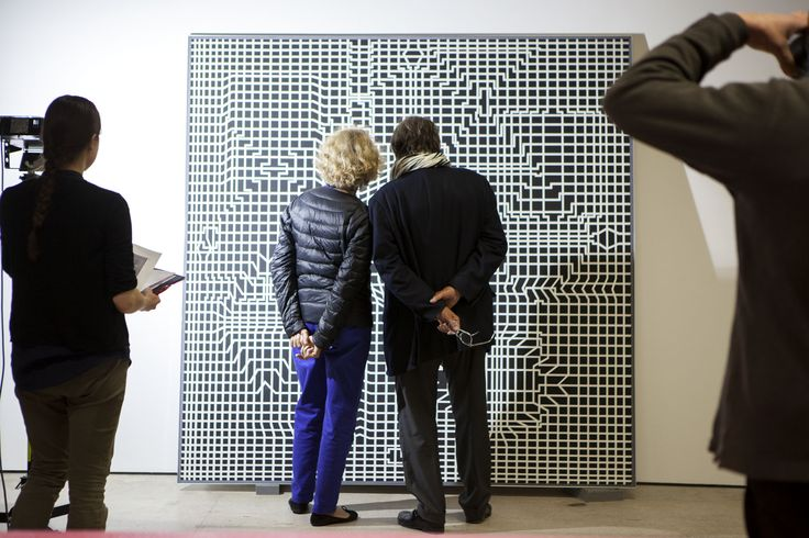 Setting up the exhibition Victor Vasarely / optical paintings. Photo: Curator Serge Lemoine and his wife.