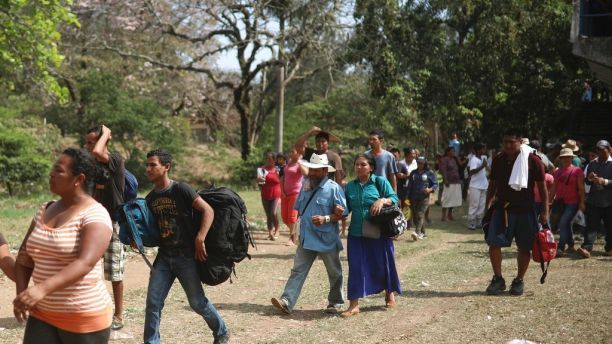 "Central American migrants arrive to a sports center during the annual Migrant Stations of the Cross caravan or ""Via crucis,"" organized by the ""Pueblo Sin Fronteras"" activist group, as the group makes a few-days stop in Matias Romero, Oaxaca state, Mexico, Monday, April 2, 2018. The organized portions of the caravans usually don't proceed much farther north than the Gulf coast state of Veracruz, while some migrants, moving as individuals or in smaller groups, often take buses or trucks from…"
