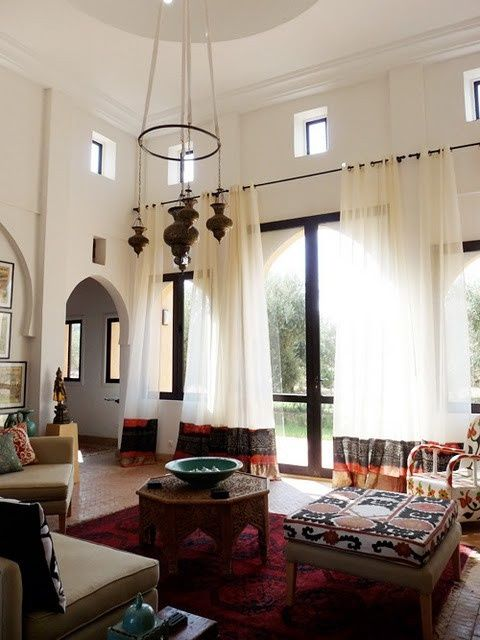 Moroccan living... I want a carved table, rug, and some of those lanterns, someday!