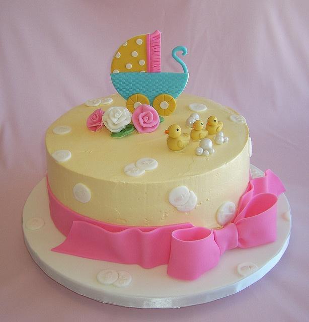 Carriage Baby Shower Cake Utilizing both buttercream and fondant.
