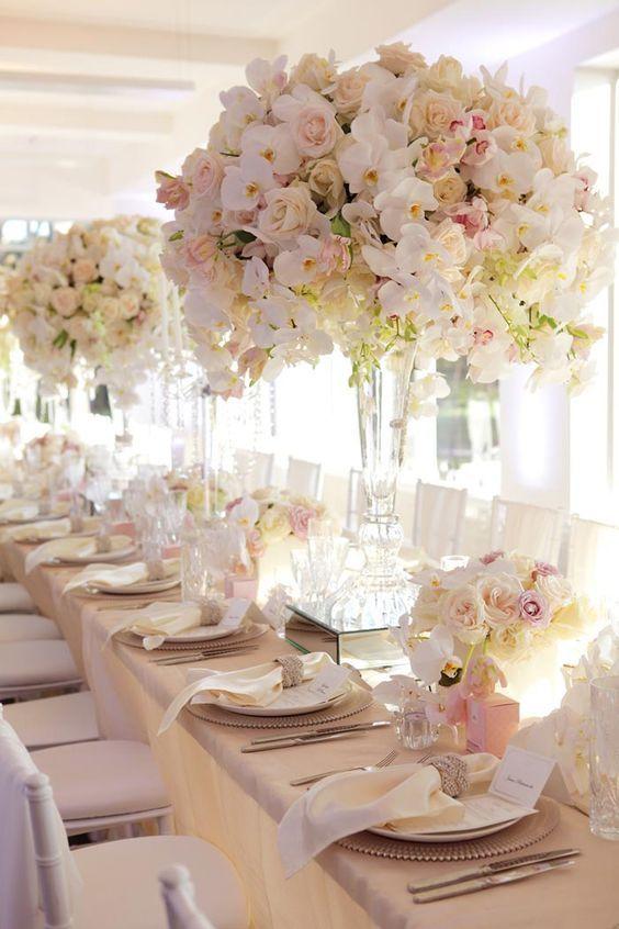 floral wedding decorations by karen tran / http://www.himisspuff.com/simple-elegant-all-white-wedding-color-ideas/6/