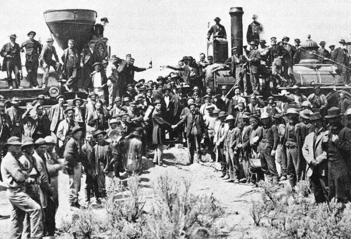 """""""Six years after work began in 1862, the laborers of the Central Pacific Railroad from the west and the Union Pacific Railroad from the east met at Promontory Summit, Utah. It was there on May 10, 1869 that Governor Leland Stanford (one of the """"Big Four"""" owners of the Central Pacific) drove the Golden Spike on the special tie of polished California laurel."""""""