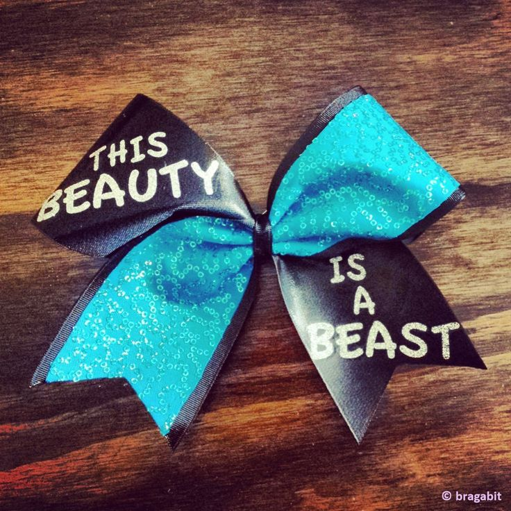 turquoise sequins and black mystique this beauty is a beast cheer bow