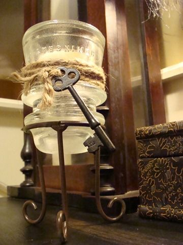 Old Insulator as a tea light candle holder...wrapped with twine and a skeleton key...
