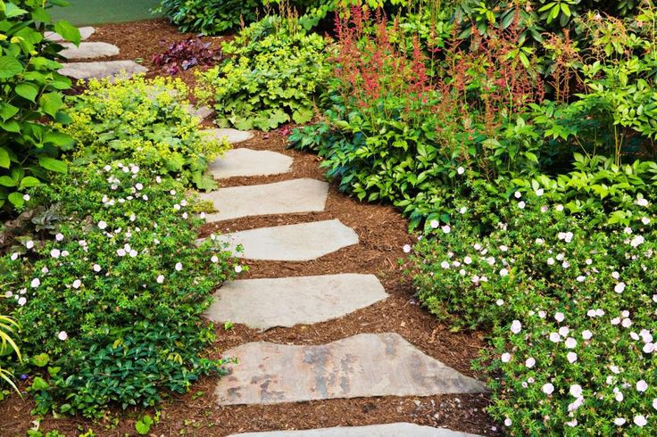 Wouldn't we all love an enchanting stepping stone garden path?