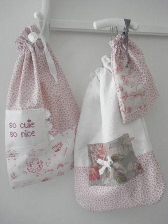 bags to hang on white rack by sewing machine..scraps, zippers, lace...etc