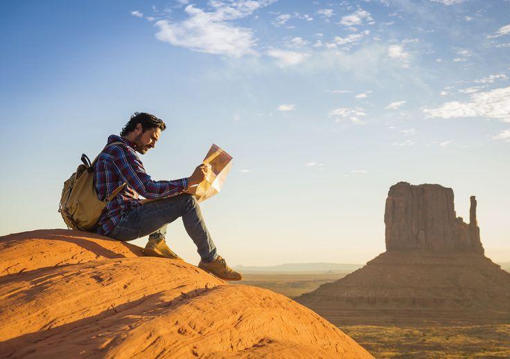 Hispanic man reading map in remote desert by Gable Denims on 500px