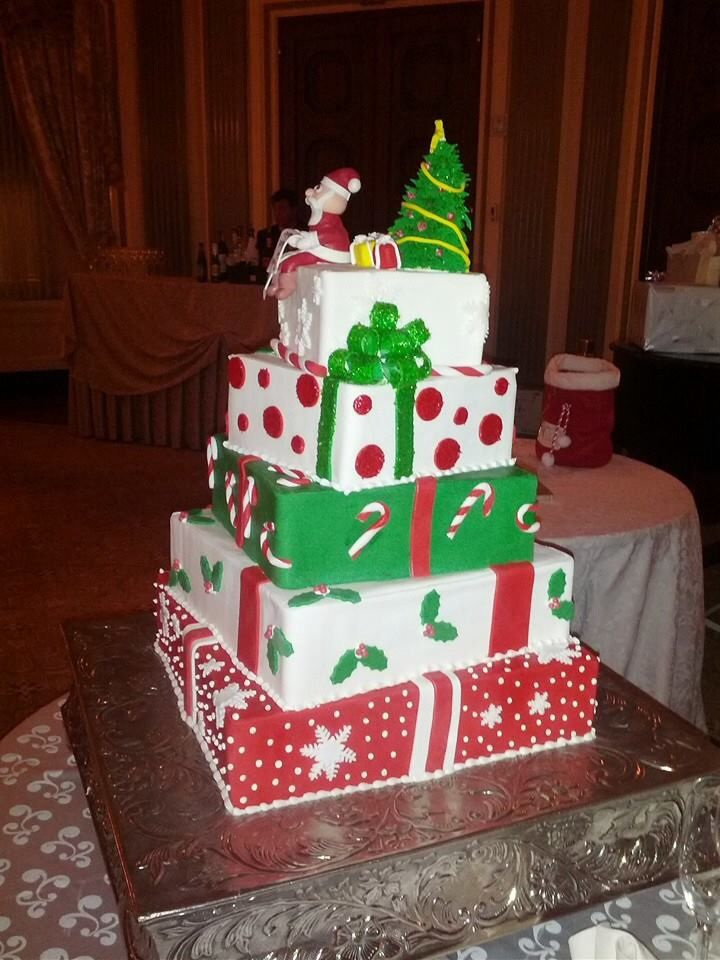 Our Christmas presents wedding cake! Santa on top has a list with our names and our furry monsters!