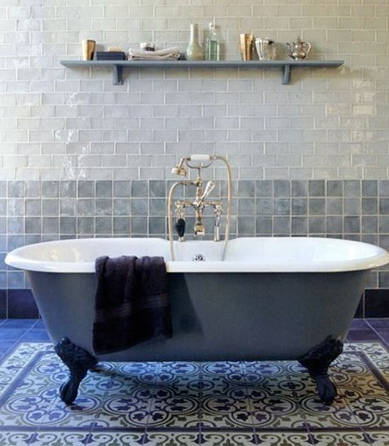 Bathroom with Moroccan floor tiles and shiny wall tiles #roll top #bath #tub