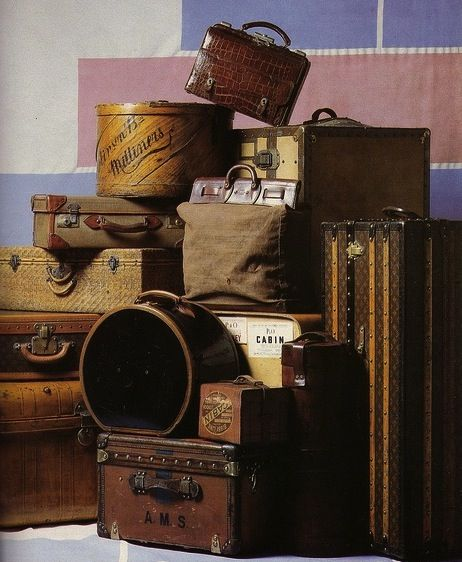 stack of vintage luggage...Louis Vuitton...canvas...leather...alligator....