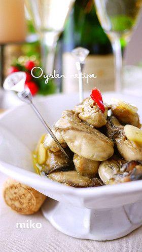 冬のおつまみ♪大蒜香る牡蠣のオイル漬け  ◆レシピ本&600大感謝(人-)丁寧に作ると縮みが少なく味も◎残ったオイルはパンにつけたり、パスタに絡めたり残さずどうぞ  ©cookpad