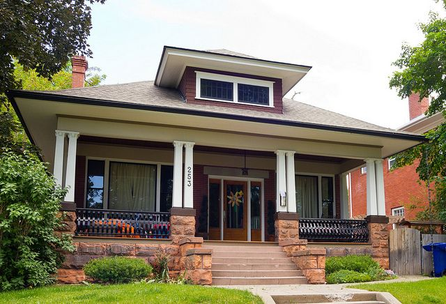 Like the little skinny side windows next to front door & centered stairway onto porch. Don't like the double porch posts, the metal rails (prefer wood), or the lack of exposed rafter tails.